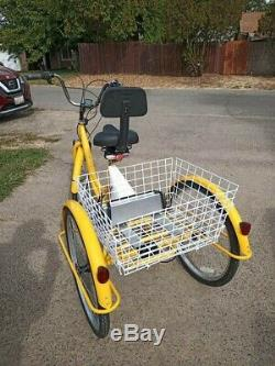 Yellow Electric tricycle 36 volts 450 watt. Rear wheel drive